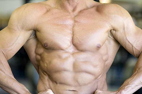 how to make your muscles look bigger in pictures